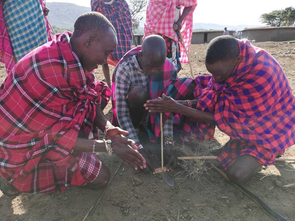 Maasai Village - hand drill method of starting a fire